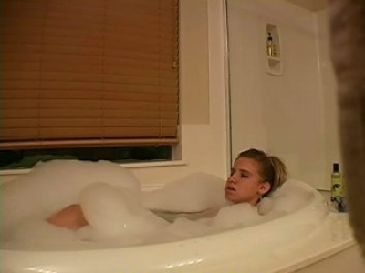 Sexy blonde babe masturbating in bubble bath on hidden cam